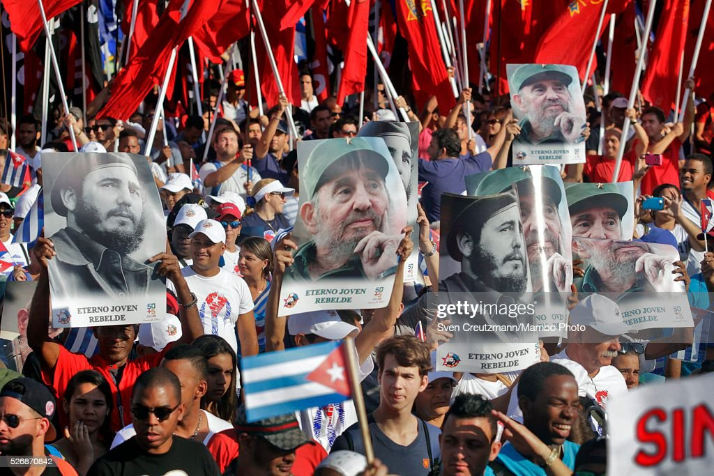 Cubans carry photos of Revolution leader Fidel Castro on occasion of his upcoming 90th birthday in August, during a march celebrating workers day, at the Plaza de la Revolucion, on May 1, 2016 in Havana, Cuba. Cuba celebrates workers day shortly before the arrival of the first US American cruise ship to arrive in Cuba, on Monday, May 2, 2016.