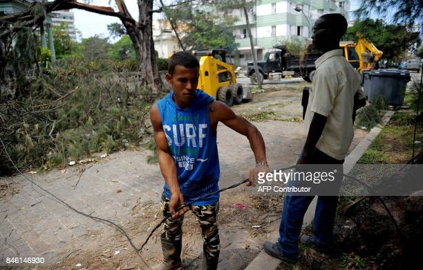 Cubans clean the streets during the cleanup ensuing the passage of Hurricane Irma in Havana on September 12 2017 / AFP PHOTO / YAMIL LAGE