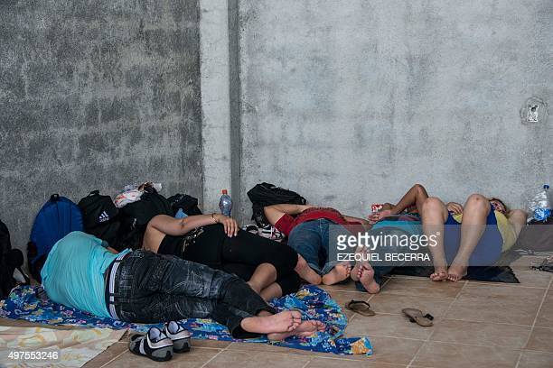 Cubans from a group of 150 rest in a shelter in the town of La Cruz Guanacaste Costa Rica near the border with Nicaragua on November 17 2015 A surge...