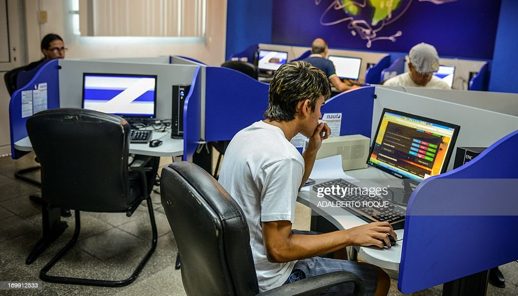 Cubans gather at a cyber place in Havana on June 4 2013 The government opened today 118 places with full internet access in 334 computers with a cost...