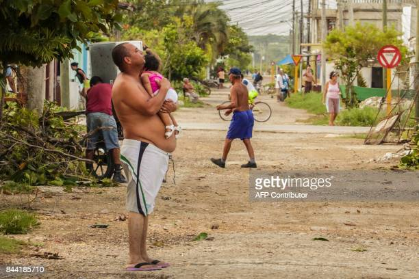 Cubans get ready on September 8 2017 for the arrival of Hurricane Irma in Caibarien the only town in the Cuban north central zone under a hurricane...
