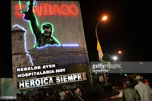Cubans leave Revolution Square following mass by Pope Benedict XVI on March 26 2012 in Santiago de Cuba Cuba Fourteen years after Pope John Paul II...