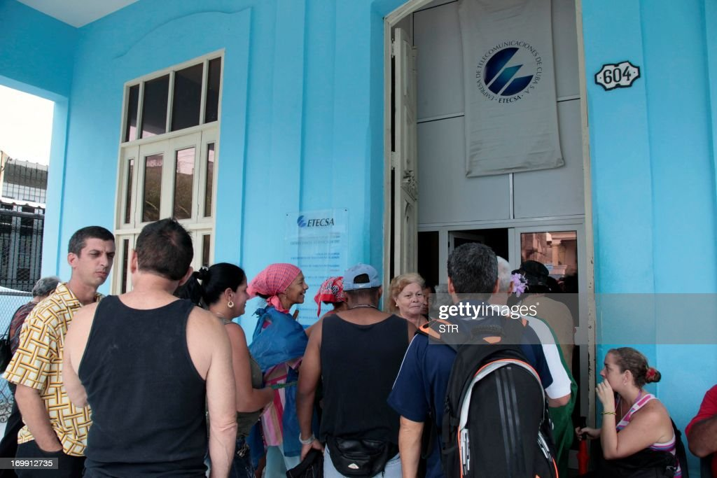 Cubans line up at a cyber place in Havana on June 4 2013 The government opened today 118 places with full internet access in 334 computers with a...