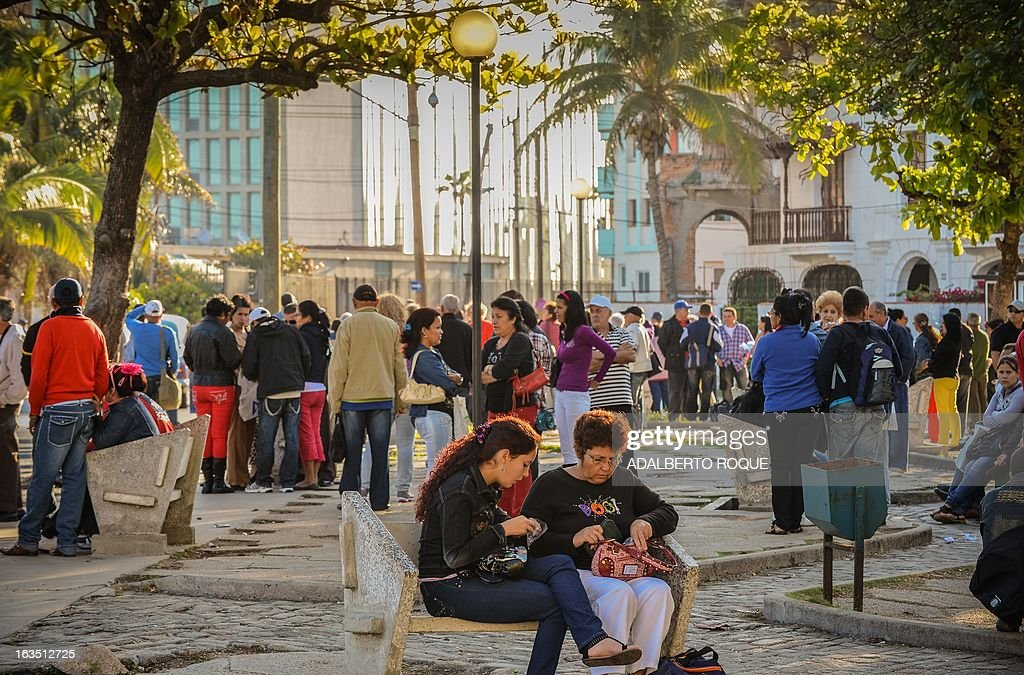 Cubans line up in front of the United States Interests Section (SINA) in Havana to get the visa to travel to the U.S