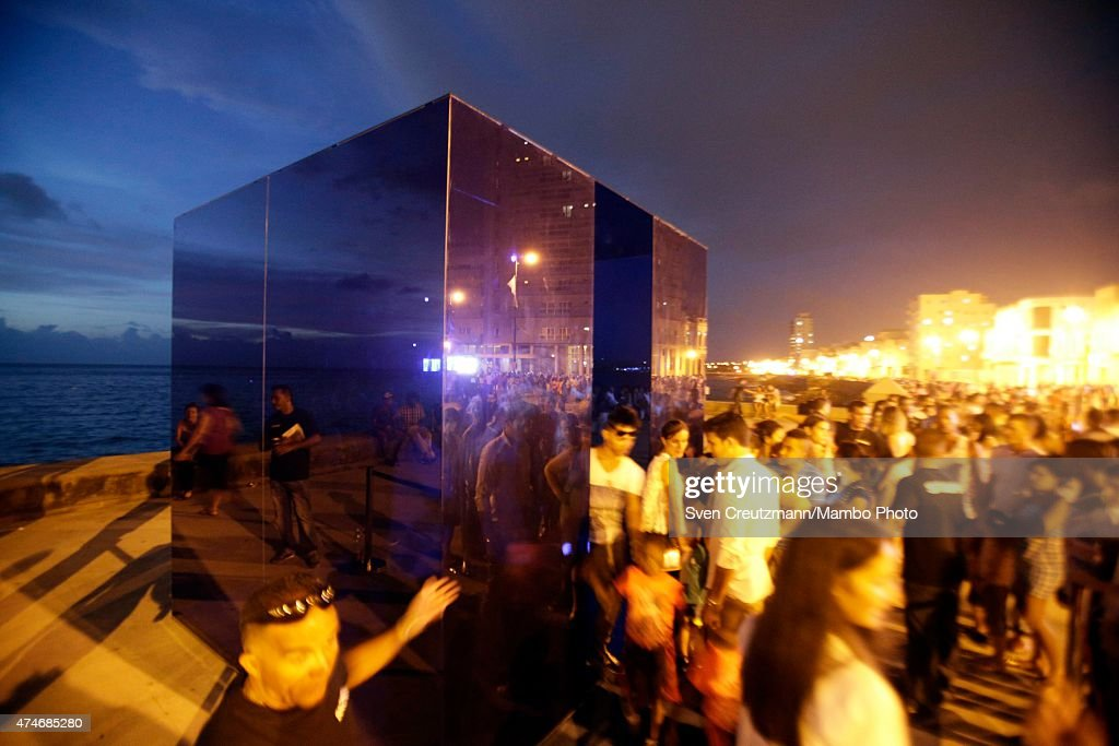 Cubans look at artwork, part of the Behind the Wall project at Havanas Malecon waterfront during the 12th Bienal art fair, on May 24, 2015 in Havana, Cuba. The biennial runs through June 22.