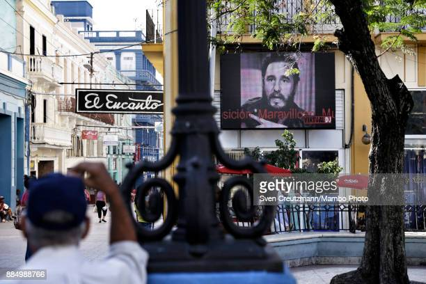Cubans look at projections of photos of late Cuban Revolution leader Fidel Castro as Cuba commemorates the first anniversary of Castro's funeral on...