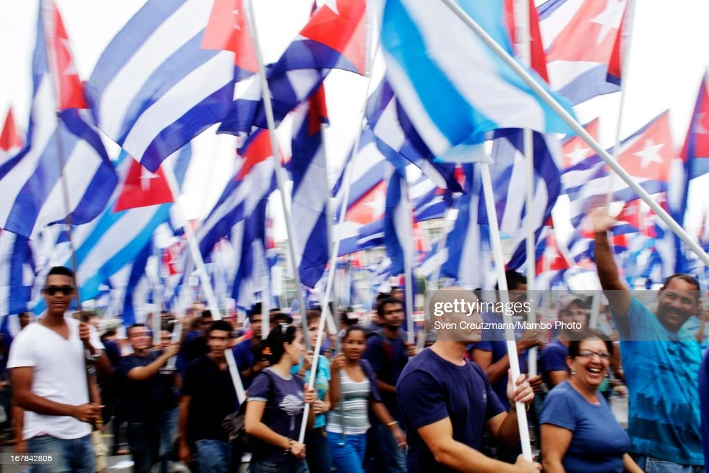 Cubans march holding hundreds of Cuban flags as closing the annual May Day parade of hundreds of Cubans at the Revolution Square on May 1, 2013 in Havana, Cuba. Former president Fidel Castro last attended a May Day parade in 2006, before he fell ill, just two months later.