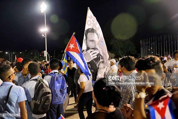 Cubans participate in a memorial tribute in Revolution Square December 3 in Santiago de Cuba Cuba The tribute is for Cubas former President the late...