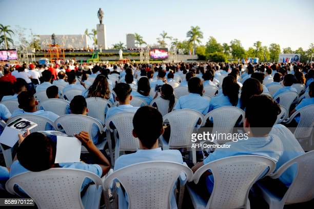 Cubans participate in the commemoration of the 50th anniversary of Ernesto 'Che' Guevara's death at the Che Guevara Memorial in Santa Clara Cuba on...