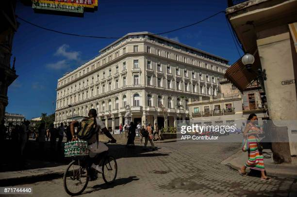 Cubans pass in front of Kempinski Hotel of Havana banned from US Treasury on November 8 2017 Tighter restrictions on US travellers to Cuba will go...