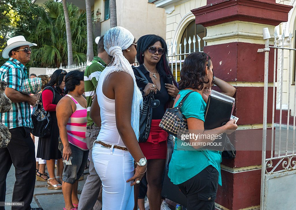 Cubans queue outside a Migration Office to request new passports, on January 14, 2013 in Havana. A law allowing Cubans to travel abroad without special exit visas took effect on the communist-ruled island for the first time in half a century. The measure does away with the exit visas that have kept most Cubans from ever traveling abroad.
