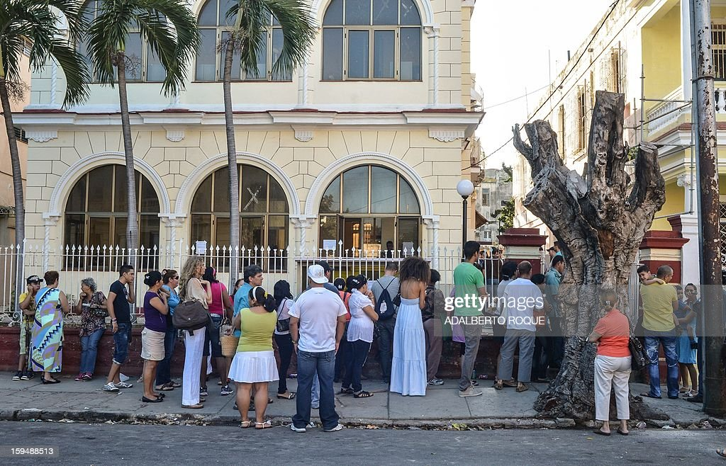 Cubans queue outside a Migrations Office to request new passport, on January 14, 2013 in Havana. A law allowing Cubans to travel abroad without special exit visas took effect on the communist-ruled island for the first time in half a century. The measure does away with the exit visas that have kept most Cubans from ever traveling abroad.