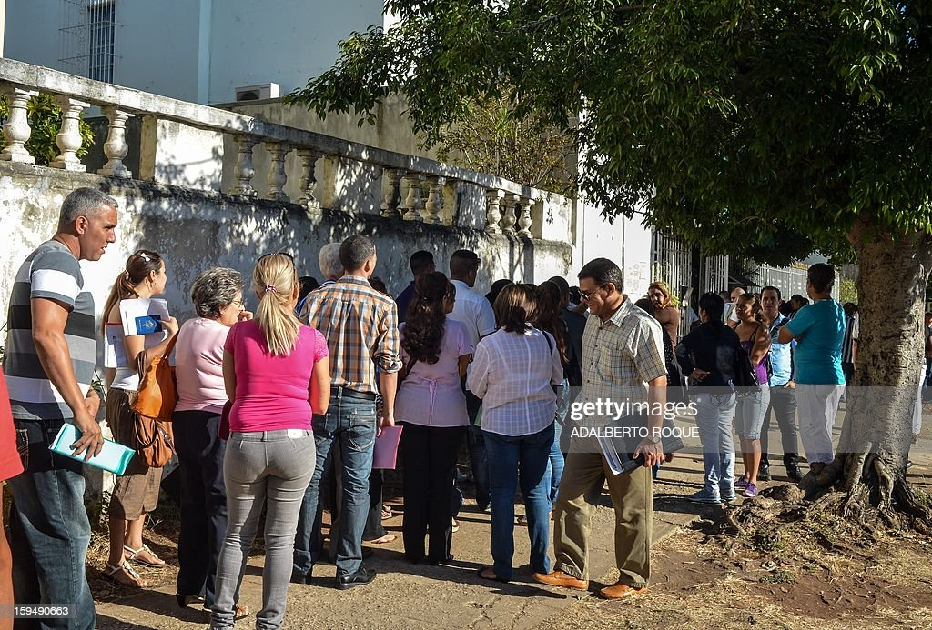 Cubans queue outside the Mexican Embassy in Havana, to request visas, on January 14, 2013. A law allowing Cubans to travel abroad without special exit visas took effect on the communist-ruled island for the first time in half a century. The measure does away with the exit visas that have kept most Cubans from ever traveling abroad.