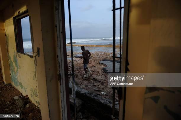 Cubans recover their belongings after the passage of Hurricane Irma in Cojimar neighborhood in Havana on September 10 2017 Residents of Cuba's...