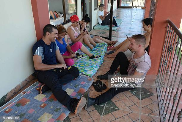 Cubans rest at a Methodist church sheltering 35 Cuban refugees in Liberia Guanacaste Costa Rica on December 29 2015 Costa Rica on Tuesday warned it...