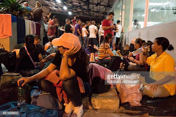 Cubans rest at the Migrations office in Penas Blancas Guanacaste Costa Rica on the border with Nicaragua on November 16 2015 A surge of some 2000...
