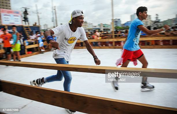 Cubans skate in an artificial ice rink in Havana on May 24 2015 The ice rink is part of a performance by IrishAmerican artist Duke Riley within the...
