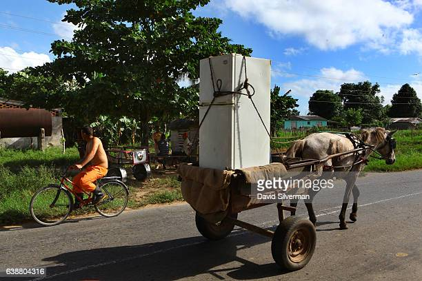 Cubans transport a used fridge by horsecart December 21 2015 along a country road in Pinar del Rio Cuba The picturesque valley famous for its tobacco...