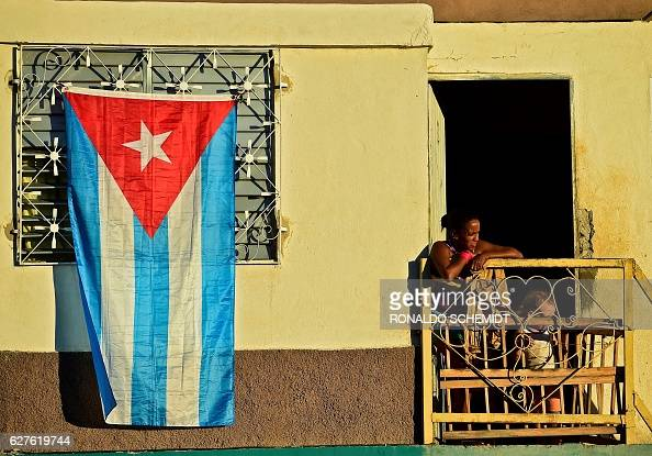 Cubans wait for the passage of the urn with the ashes of Cuban leader Fidel Castro on its way to the cemetery near Revolution Square in Santiago Cuba...