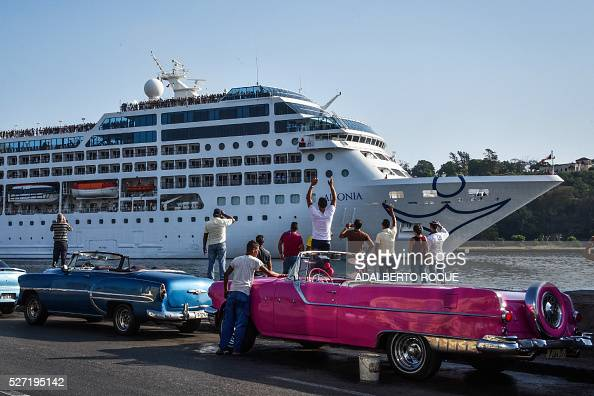 TOPSHOT Cubans watch as the first UStoCuba cruise ship to arrive in the island nation in decades glides into the port of Havana on May 2 2016 The...