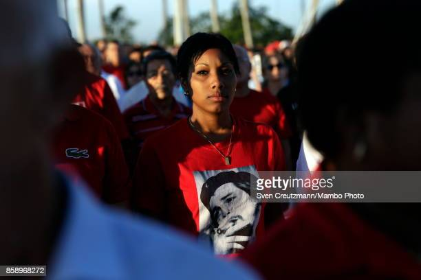 Cubans wear TShirts with the image of Che Guevara during a political act at the Plaza de la Revolucion to celebrate the 50th anniversary of the death...