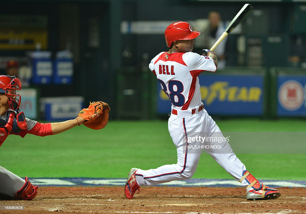 Cuba's Alexei Bell (R) hits a two-run home run against China during the fourth inning of their first-round Pool A game in the World Baseball Classic tournament in Fukuoka on March 4, 2013.