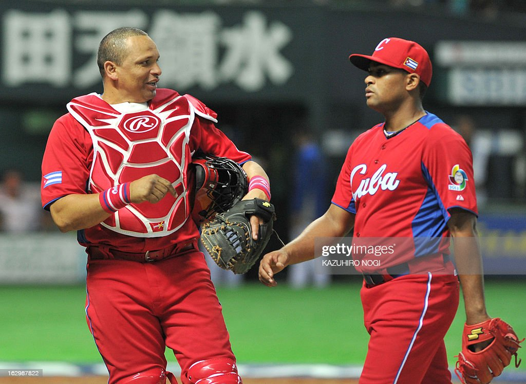 Cuba's catcher Eriel Sanchez (L) speaks to relief pitcher Freddy Alvarez (R) after the fifth inning of their first-round Pool A game against Brazil in the World Baseball Classic tournament in Fukuoka on March 3, 2013.