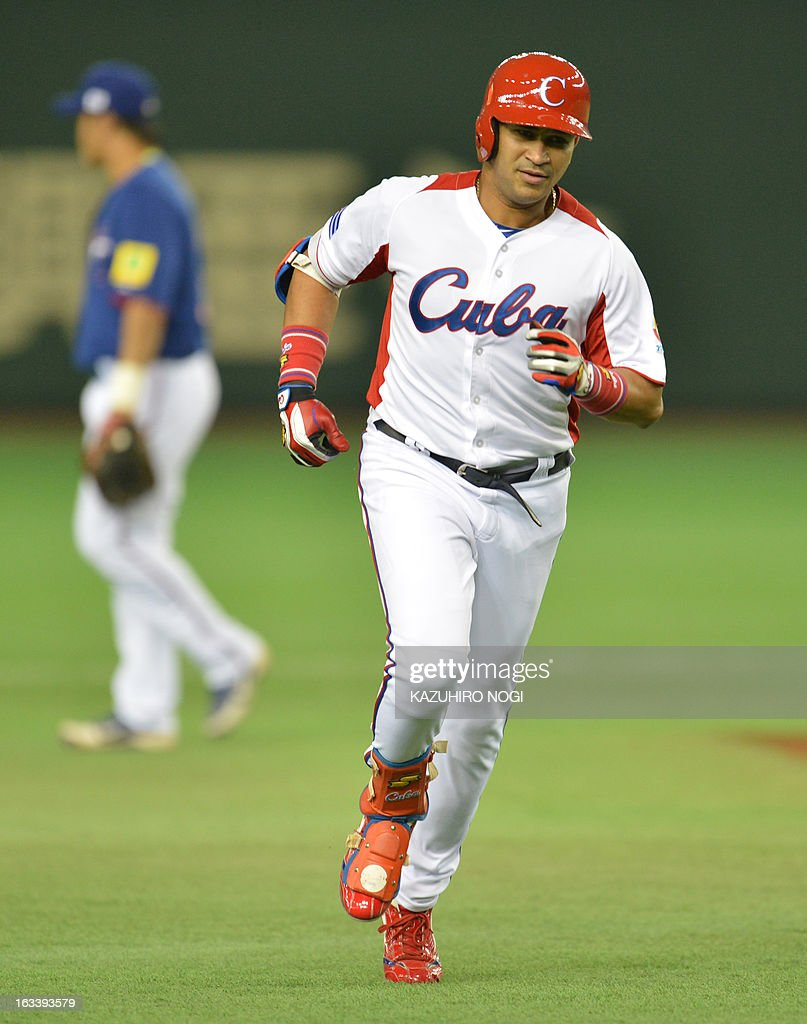Cuba's Frederich Cepeda (R) runs a field after his two-run homer against Taiwan during the first inning of their second-round Pool 1 game in the World Baseball Classic tournament at the Tokyo Dome on March 9, 2013.