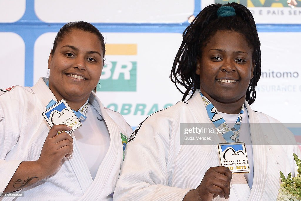 Cuba's gold medalist <a gi-track='captionPersonalityLinkClicked' href=/galleries/search?phrase=Idalys+Ortiz&family=editorial&specificpeople=5492242 ng-click='$event.stopPropagation()'>Idalys Ortiz</a> (R) and Brazil's silver medalist Maria Suelen Altheman pose on the podium during the medal ceremony for the women's +78kg category during the World Judo Championships at Gymnasium Maracanazinho on August 31, 2013 in Rio de Janeiro, Brazil.