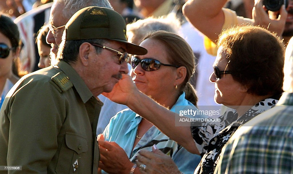 Cuba's interim president Raul Castro (L) greets the widow of revolutionary leader Ernesto 'Che' Guevara, Aleida March, during the official ceremony to commemorate the 40th anniversary of El Che's death on October 8th, 2007, at the Revolution Square in the Cuban eastern village of Santa Clara. For decades a global symbol of rebellion, Ernesto 'Che' Guevara is to be honored today with ceremonies in Cuba, where his myth was forged, and Bolivia, where he was executed 40 years ago spreading the gospel of Marxist revolution.