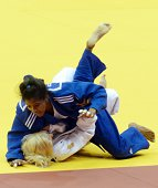 Cuba's judoka Dayaris Mestre Alvarez competes with Ukraine's Maryna Cherniak during the under 48 kg category quarterfinal of the IJF World Judo...