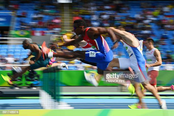 TOPSHOT Cuba's Leonel Suarez competes in the Men's Decathlon 110m Hurdles during the athletics event at the Rio 2016 Olympic Games at the Olympic...