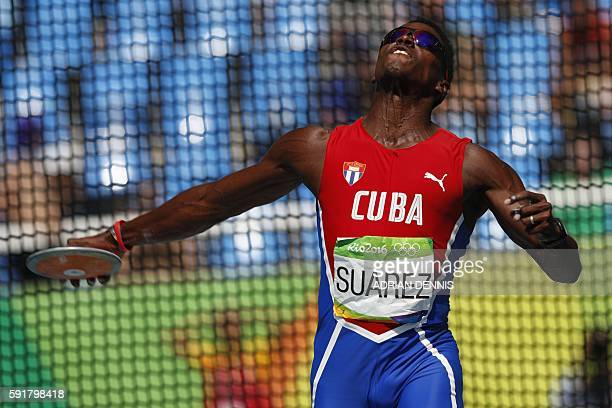 Cuba's Leonel Suarez competes in the Men's Decathlon Discus Throw during the athletics event at the Rio 2016 Olympic Games at the Olympic Stadium in...