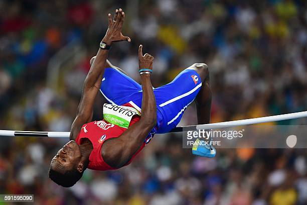 Cuba's Leonel Suarez competes in the Men's Decathlon High Jump during the athletics event at the Rio 2016 Olympic Games at the Olympic Stadium in Rio...