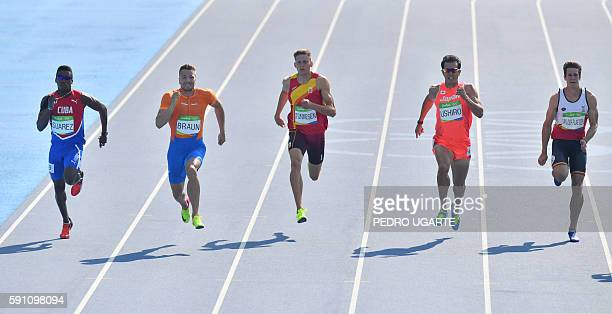 Cuba's Leonel Suarez Netherlands' Pieter Braun Spain's Pau Tonnesen Japan's Keisuke Ushiro and Belgium's Thomas van der Plaetsen compete in a Men's...