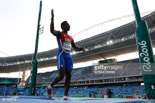 Cuba's Leonel Suarez reacts while competing in the Men's Decathlon Pole Vault during the athletics event at the Rio 2016 Olympic Games at the Olympic...