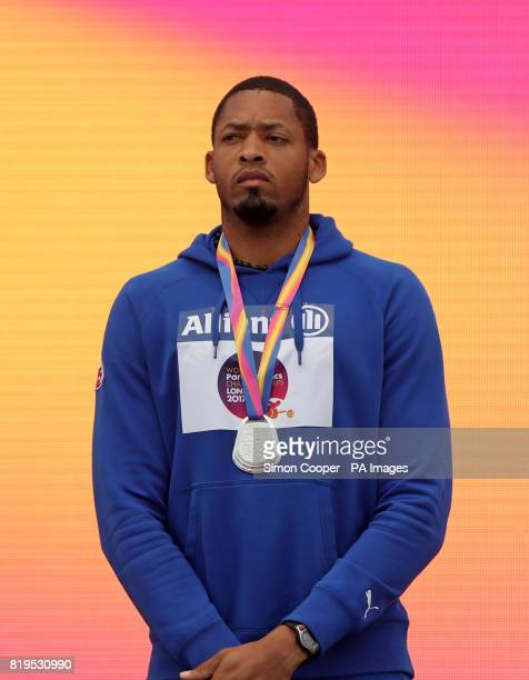 Cuba's Luis Felipe Gutierrez with his silver medal after the Men's High Jump T13 Final after the Men's F57 Javelin during day five of the 2017 World...