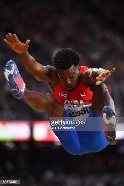 Cuba's Maykel Massó competes in the final of the men's long jump athletics event at the 2017 IAAF World Championships at the London Stadium in London...