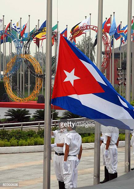 Cuba's national flag is hoisted at the central square of the Olympic Village on August 6 2008 Cuban authorities and athletes participating in the...
