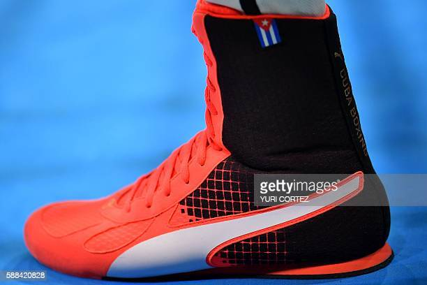 Cuba's national flag is seen on Robeisy Ramirez's shoe as he fights India's Shiva Thapa during the Men's Bantam match at the Rio 2016 Olympic Games...