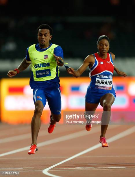 Cuba's Omara Durand and guide Yuniol Kindelan win the Women's 400m T12 final during day six of the 2017 World Para Athletics Championships at London...