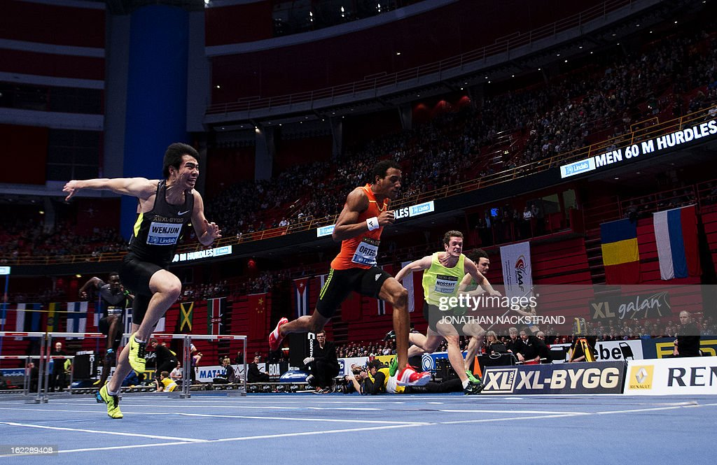 Cuba's Orlando Ortega (C) competes to win against China's Xie Wenjun (L) the men's 60m hurdles event of the XL Galan Stockholm Athletics Indoor meeting on February 21, 2013 at the Ericsson Globe Arena in Stockholm.