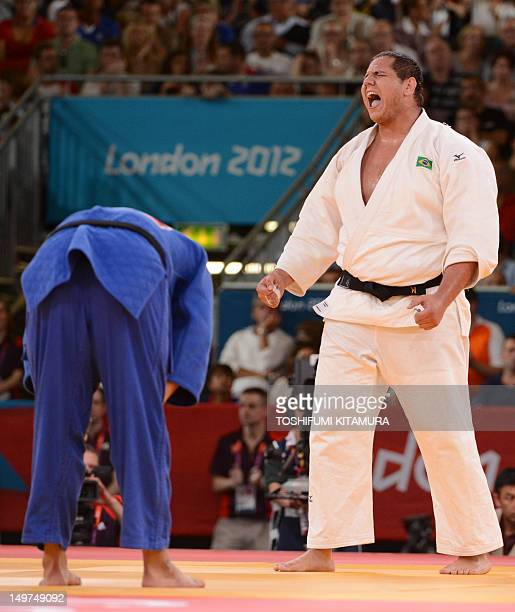 Cuba's Oscar Brayson celebrates after winning against Korea's Kim SungMin his men's 100kg judo contest bronze medal match of the London 2012 Olympic...