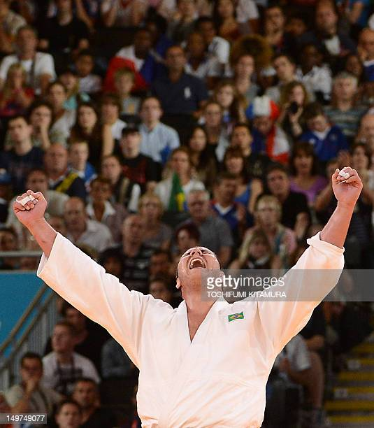 Cuba's Oscar Brayson celebrates after winning his men's 100kg judo contest bronze medal match of the London 2012 Olympic Games on August 3 2012 at...