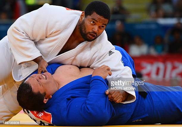 Cuba's Oscar Brayson competes with Guam's Ricardo JR Blas during their men's 100kg judo contest match of the London 2012 Olympic Games on August 3...