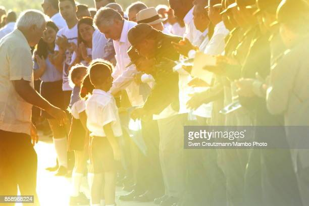 Cubas President Raul Castro greets pioneers during a political act at the Plaza de la Revolucion to celebrate the 50th anniversary of the death of...