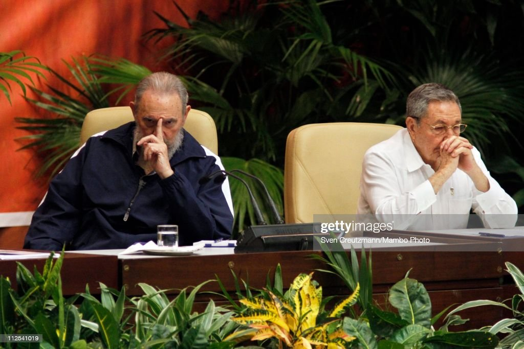 Cuba's Revolution leader <a gi-track='captionPersonalityLinkClicked' href=/galleries/search?phrase=Fidel+Castro&family=editorial&specificpeople=67210 ng-click='$event.stopPropagation()'>Fidel Castro</a> (L) and his brother <a gi-track='captionPersonalityLinkClicked' href=/galleries/search?phrase=Raul+Castro&family=editorial&specificpeople=239452 ng-click='$event.stopPropagation()'>Raul Castro</a>, President of Cuba react as the new members of the Central Committee are being announced during the closing session of the 6th Party Congress after <a gi-track='captionPersonalityLinkClicked' href=/galleries/search?phrase=Raul+Castro&family=editorial&specificpeople=239452 ng-click='$event.stopPropagation()'>Raul Castro</a> had been officially elected as <a gi-track='captionPersonalityLinkClicked' href=/galleries/search?phrase=Fidel+Castro&family=editorial&specificpeople=67210 ng-click='$event.stopPropagation()'>Fidel Castro</a>'s successor as head of Cuba's ruling communist Party PCC in the Palacio de las Convenciones on April 19, 2011 in Havana, Cuba. Cuba's party met for three days to approve economic reforms.