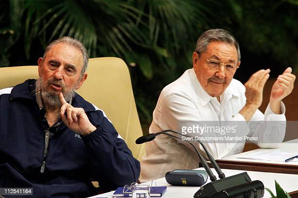 Cuba's Revolution leader Fidel Castro and his brother Raul Castro President of Cuba react as the new members of the Central Committee are being...