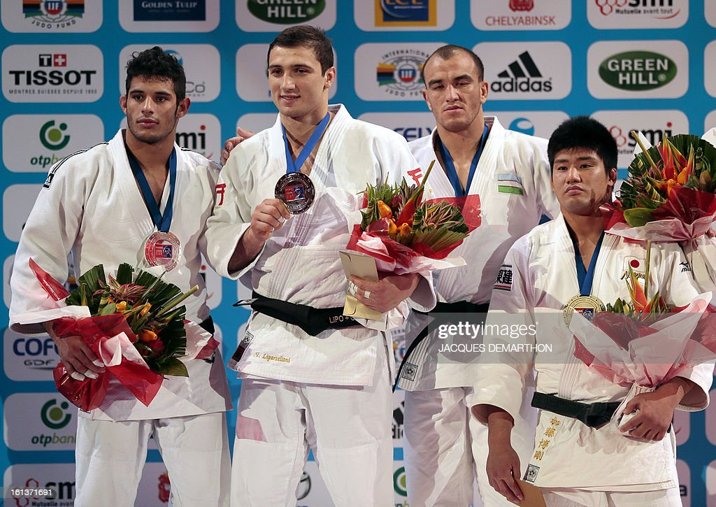 Cuba's second-placed Asley Gonzalez, Georgia's first placed Varlam Liparteliani and third placed Uzbekistan's Dilshod Choriev and Japan's Kato Hirotaka pose with their medals, on the podium after the Men's -90kg category final of the Paris Judo Grand Slam tournament, at the Palais Omnisports de Paris-Bercy (POPB) in Paris, on February 10, 2013.