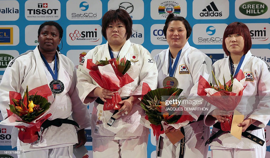 Cuba's second-placed Idalys Ortiz, Japan's first-placed Tachimoto Megumi and third placed Korea's Kim Jiyoun, and Korea's Kim Eun Gyeong (3rd) pose with their medals on the podium of the Women's +78kg category of the Paris Judo Grand Slam tournament, at the Palais Omnisports de Paris-Bercy (POPB) in Paris, on February 10, 2013. AFP PHOTO/JACQUES DEMARTHON
